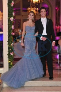 HRH Princess Charlotte de Bourbon, Princess of Parma wearing an Atelier Versace dress with her escort HRH Prince Amaury de Bourbon