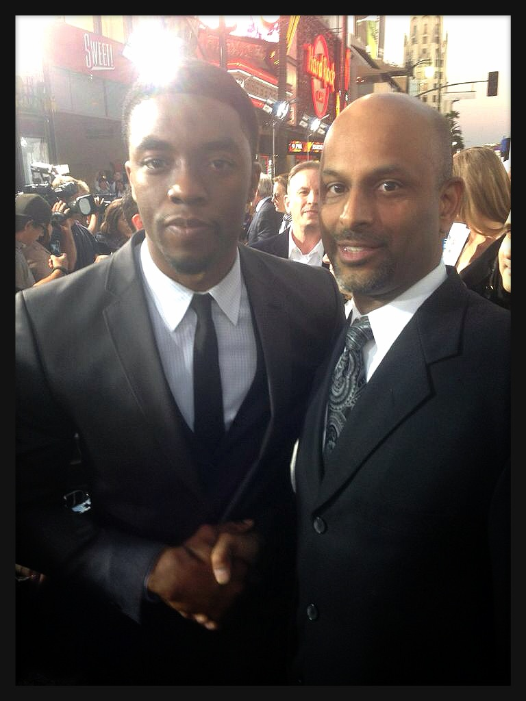 Chadwick Boseman with Apoorva Gandhi, VP Multicultural Markets and Alliances, Marriott International at the premiere of '42'